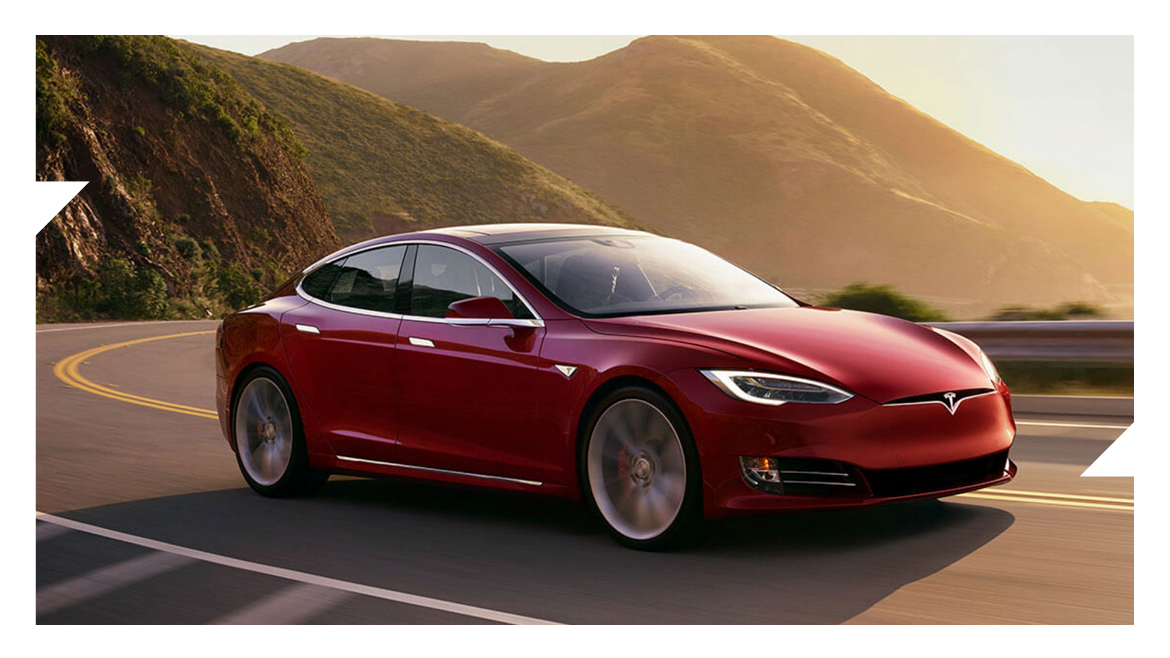 Red Tesla with a hilly background